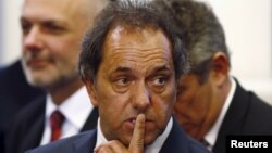 FILE - Daniel Scioli, governor of Buenos Aires province, gestures during a ceremony at the Casa Rosada Presidential Palace in Buenos Aires, September 30, 2014.