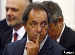 FILE - Daniel Scioli, governor of Buenos Aires province, gestures during a ceremony at the Casa Rosada Presidential Palace in Buenos Aires, Sept. 30, 2014.