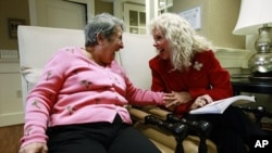 Alexis McKenzie, right, executive director of The Methodist Home of the District of Columbia Forest Side, an Alzheimer's assisted-living facility, shares a light moment with resident Catherine Peake, in Washington, February 6, 2012.