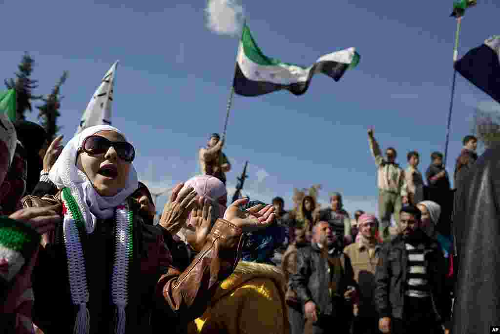 A woman chants anti-government slogans during a protest in north Syria. (AP)