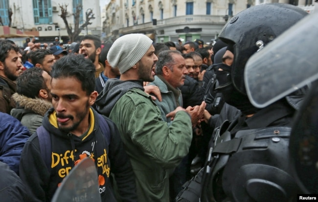 Tunisian protesters clash with riot police during demonstrations against rising prices and tax increases, in Tunis, Tunisia, Jan. 12, 2018.