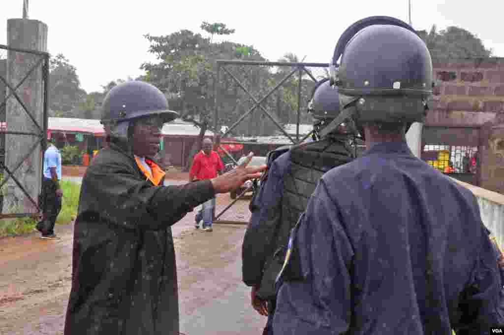 Liberian police are deployed at an Ebola treatment center to provide security, Monrovia, Liberia, Aug. 18, 2014.