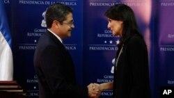 Honduran President Juan Orlando Hernandez shakes hands with Nikki Haley, U.S. ambassador to the United Nations, in Tegucigalpa, Honduras, Feb. 27, 2018.