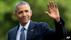 FILE - President Barack Obama waves as he walks across the South Lawn of the White House, in Washington, as he returns from Charlotte, N.C. where he participated in a campaign event with Democratic presidential candidate Hillary Clinton, July 5, 2016.