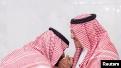 Newly appointed Crown Prince Mohammed bin Salman (L) kisses the hand of Prince Mohammed bin Nayef in Mecca, Saudi Arabia, June 21, 2017.