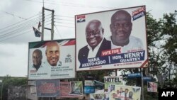 FILE - The campaign billboards of Ghana's two main political parties running in this year's national election are shown in the streets of Accra in Ghana, Oct. 8, 2016.