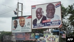 The campaign billboards of Ghana's two main political parties competing in this year's national elections are seen in the streets of Accra in Ghana, Oct. 8, 2016.