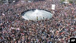 Syrian President Bashar al-Assad's supporters gather to demonstrate their support for their president, in Damascus, March 29, 2011