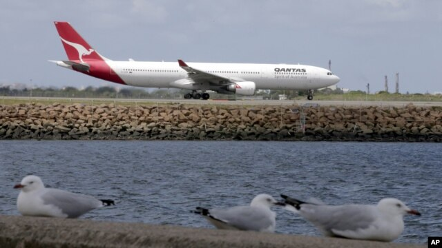FILE - A Qantas plane prepares to take off at Sydney Airport, at Sydney, Australia.