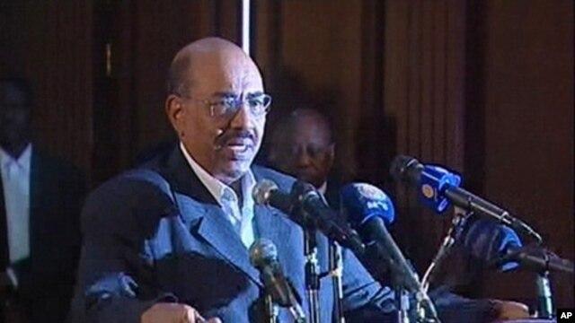 In this still image taken from video, Sudanese President Omar Hassan al-Bashir speaks during an address on state TV in Khartoum, February 7, 2011