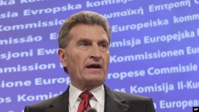 European Commissioner for Energy Guenther Oettinger addresses the media at the European Commission headquarters in Brussels, May 25, 2011