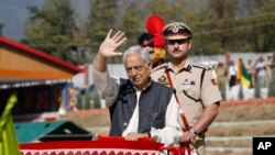 FILE - Jammu and Kashmir state chief minister Mufti Mohammad Sayeed waves during the graduation parade of newly recruits of the state police in Manigham, northeast of Srinagar, Indian controlled Kashmir.