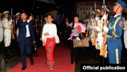 daw aung san suu kyi china trip start