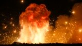 FILE - A powerful explosion is seen in the ammunition depot at a military base in Kalynivka, west of Kiev, Ukraine, early Wednesday, Sept. 27, 2017. (AP Photo/Efrem Lukatsky)