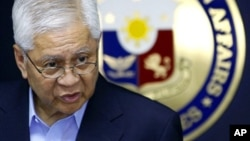 Philippine Foreign Affairs Secretary Albert Del Rosario addresses the media during a press conference in suburban Pasay City, south of Manila, Philippines, after his return from the ASEAN Regional Forum in Cambodia Friday, July 13, 2012. Del Rosario deplo
