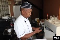 Samuel Kinuthia, a chef in Nairobi, uses Branch for loans for his business. (L. Ruvaga/VOA)