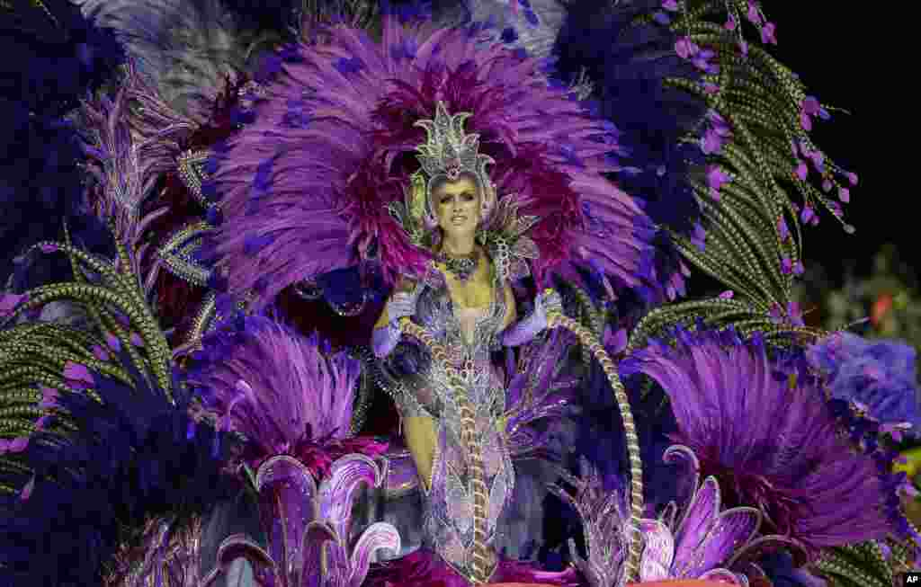 A dancer from the Mocidade Alegre samba school performs on a float during a carnival parade in Sao Paulo, Brazil.