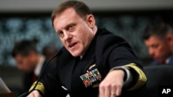 FILE - U.S. Cyber Command and National Security Agency Director Admiral Mike Rogers testifies on Capitol Hill in Washington before the Senate Armed Services Committee, May 9, 2017.