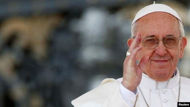 Pope Francis waves as he leads the weekly audience in Saint Peter's Square at the Vatican, April 10, 2013.