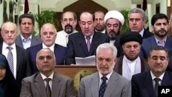 Iraq's Prime Minister Nouri al-Maliki, speaks at a podium surrounded by lawmakers, Aug. 14, 2014.
