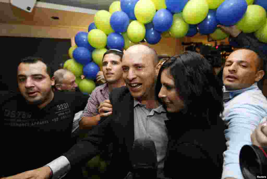 Head of the Jewish Home party Naftali Bennett arrives at his party's headquarters in Ramat Gan, near Tel Aviv, after exit polls were announced, January 22, 2013.
