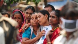 Relatives mourn as they look for a garment worker, who is missing after the collapse of the Rana Plaza building in Savar, outside Dhaka, May 2, 2013.