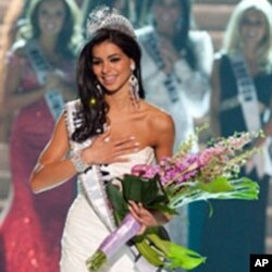 This handout photo shows Rima Fakih, 24, of Dearborn, Michigan, as she reacts after being crowned Miss USA 2010, 16 May 2010