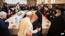 Pope Francis hugs Orthodox Ecumenical Patriarch Bartholomew I, during an interfaith day of prayer for peace, in Assisi, Italy, Sept. 20, 2016.