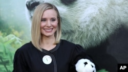 "FILE - Kristen Bell holds a panda teddy bear at the LA Premiere of ""Pandas"" at the TCL Chinese Theatre IMAX on March 17, 2018, in Los Angeles."