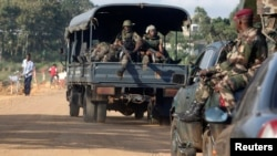 Soldiers patrol the area after an attack in Dabou, around 50 km (30 miles) west of Abidjan, Ivory Coast, Aug. 16, 2012.