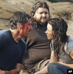 Jack (Matthew Fox, left) battles to save the island on the final episode of 'Lost.'