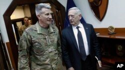 U.S. Defense Secretary James Mattis, right, and U.S. Army General John Nicholson, left, commander of U.S. Forces Afghanistan, arrive to meet with an Afghan defense delegation at Resolute Support headquarters, in Kabul Afghanistan, April 24, 2017. Mattis arrived unannounced in Afghanistan to assess America's longest war as the Trump administration weighs sending more U.S. troops.