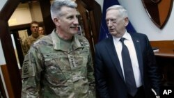 U.S. Defense Secretary James Mattis, right, and U.S. Army General John Nicholson, left, commander of U.S. Forces Afghanistan, arrive to meet with an Afghan defense delegation at Resolute Support headquarters, in Kabul Afghanistan, April 24, 2017. Mattis a