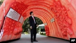Assemblyman Richard Pan, D-Sacramento, who is pediatrician, passes through an inflatable colon display in Sacramento, Calif., March 24, 2014. The display shows what a healthy colon looks like, how polyps develop and how they can turn cancerous.