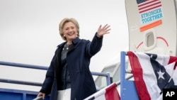 FILE - Democratic presidential candidate Hillary Clinton arrives at Pueblo Memorial Airport in Pueblo, Colo., Oct. 12, 2016, to attend a rally.