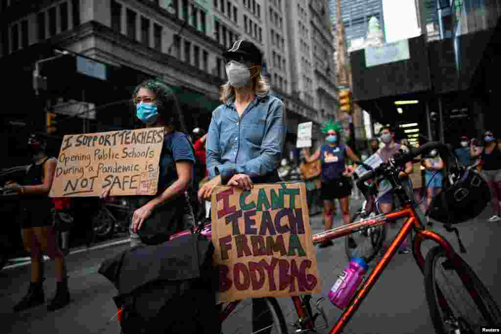 People take part in a march during the National Day of Resistance to schools re-opening amid the outbreak of the coronavirus disease (COVID-19), in New York City, Aug. 3, 2020.