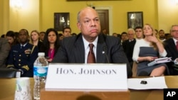 FILE - Homeland Security Secretary Jeh Johnson arrives on Capitol Hill in Washington to testify before a House Homeland Security Committee hearing on the impact of President Barack Obama's executive action on immigration, Dec. 2, 2014.