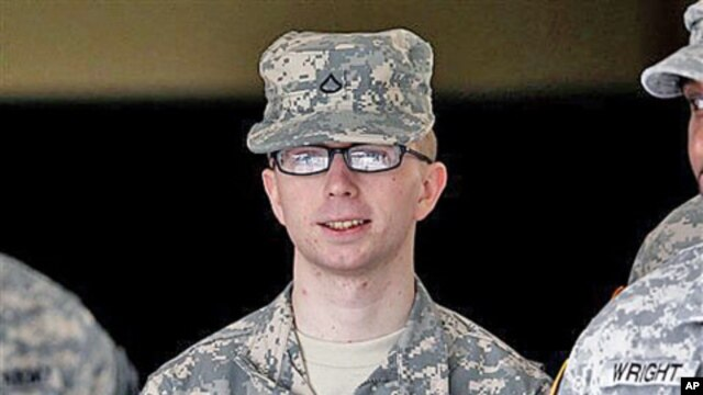 Army Private First Class Bradley Manning - a low-ranking intelligence analyst charged in the biggest leak of classified information in US history - is escorted from a courthouse in Fort Meade, Maryland, December 22, 2011.
