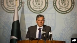 FILE - Pakistan's foreign ministry spokesman Nafees Zakaria briefs the media at the Foreign Office in Islamabad, Pakistan, Sept. 29, 2016. Zakaria alleged Thursday that India has a stockpile of fissile material for the production of nuclear weapons outside IAEA safeguards.