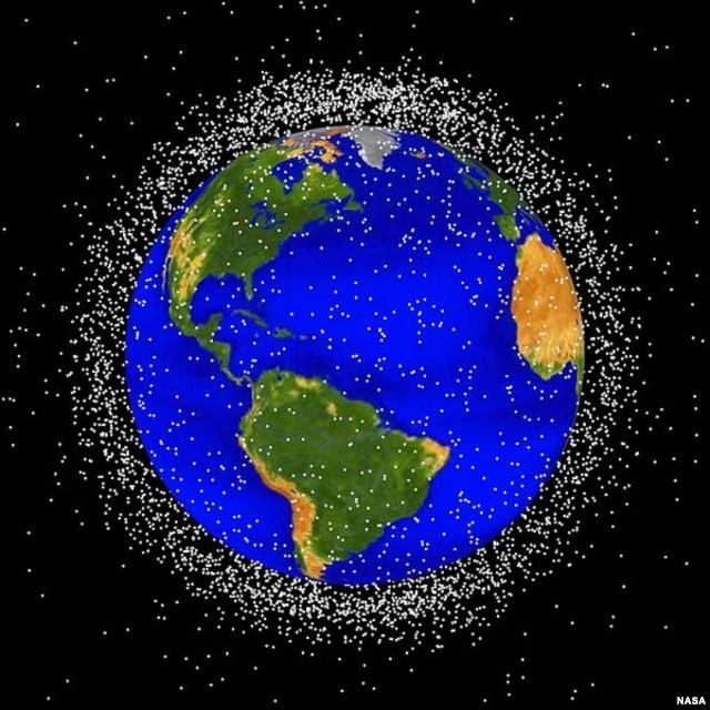 Image of Earth surrounded by orbiting objects that are currently being tracked. Approximately 95% of these objects are space debris. (NASA)