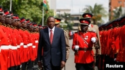 Kenya's President Uhuru Kenyatta inspects the honor guard before the opening of the 11th Parliament at the National Assembly Chamber in the capital Nairobi, Apr. 16, 2013.
