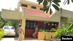 Police stand guard at the house of Gauri Lankesh, a senior Indian journalist who according to police was shot dead on Tuesday by unidentified assailants, in Bengaluru, India, September 6, 2017.