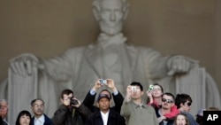 People visit the Lincoln Memorial in Washington Sunday, April 12, 2009. (AP Photo/Alex Brandon)