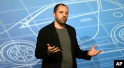 FILE - WhatsApp co-founder and CEO Jan Koum speaks during a conference at the Mobile World Congress, in Barcelona, Spain, Feb. 24, 2014.