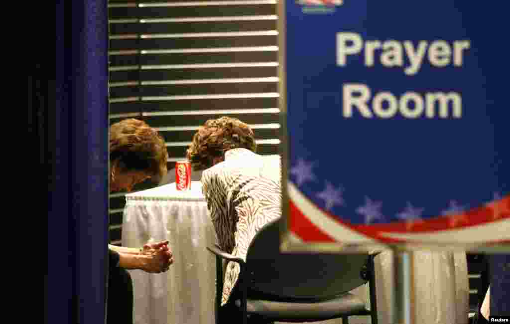 Convention goers pause in the prayer room.