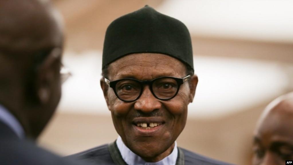 Le président nigérian Muhammadu Buhari assiste à une réception à la séance de clôture du Commonwealth Business Forum au Guildhall, au centre de Londres, le 18 avril 2018.