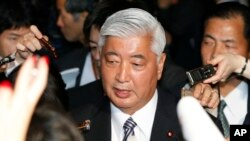 FILE - Japanese Defense Minister Gen Nakatani answers reporters' questions at the prime minister's official residence in Tokyo.