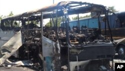 The scene following a deadly suicide attack on a bus full of Israeli vacationers at the Burgas, Bulgaria airport parking lot. After investigation, the Bulgarian government announced Hezbollah was responsible. (file)