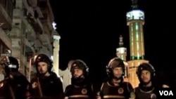 Pripadnici egipatskih snaga sigurnosti ispred koptske crkve u Aleksandriji