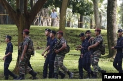 Members of the military and police patrol outside the venue for the 27th Association of Southeast Asian Nations (ASEAN) summit in Kuala Lumpur, Malaysia, Nov. 20, 2015.